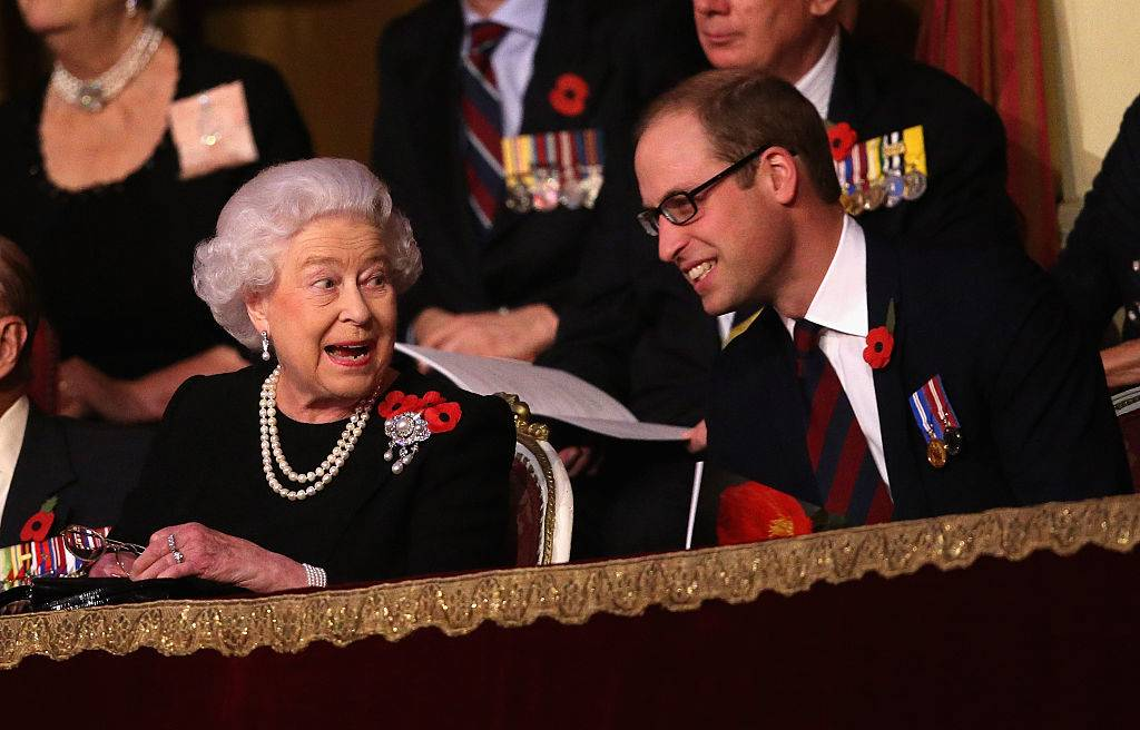 Queen Elizabeth II and Prince William, Duke of Cambridge chat to each other in the Royal Box at the Royal Albert Hall